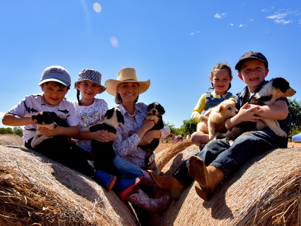 Annabel with kids and puppies at Katherine Outback Experience